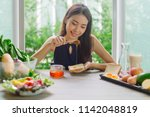young asian woman happy... | Shutterstock . vector #1142048819