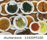 Small photo of Nasi Padang bird view, lay flat. This is How they serve food on Nasi Padang's restaurant. All foods in small plates. Pay only what you eat.