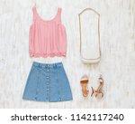 pink tank top  blue denim mini...   Shutterstock . vector #1142117240