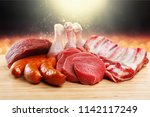 fresh raw meat on background | Shutterstock . vector #1142117249