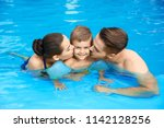 young family with little son in ... | Shutterstock . vector #1142128256