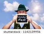 bavarian man under blue sky... | Shutterstock . vector #1142139956