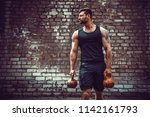 athletic man working out with a ... | Shutterstock . vector #1142161793