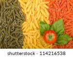 Pasta Italian flag texture with tomato and basil - stock photo