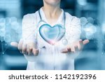 doctor or nurse protects heart... | Shutterstock . vector #1142192396
