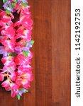 pink floral hawaiian lei... | Shutterstock . vector #1142192753