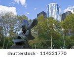 NEW YORK - SEPTEMBER 24: The US Navy Memorial Eagle in Battery Park and surrounding modern architecture of lower Manhattan on September 24,2012. - stock photo