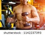 strong well built bodybuilder... | Shutterstock . vector #1142237393