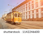 traditional tram in old porto... | Shutterstock . vector #1142246600