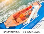 safety lifeboat on deck of a... | Shutterstock . vector #1142246603