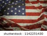 closeup of grunge american flag | Shutterstock . vector #1142251430