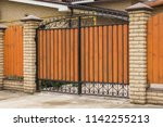 automatic gates made of wood... | Shutterstock . vector #1142255213