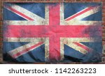 an old stained dirty union jack ... | Shutterstock . vector #1142263223