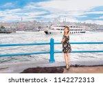 beautiful woman in black dress... | Shutterstock . vector #1142272313