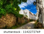 beautiful cobbled street in the ... | Shutterstock . vector #1142272769