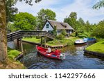 the picturesque village of ... | Shutterstock . vector #1142297666