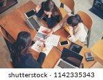 analyst corporate team meeting... | Shutterstock . vector #1142335343