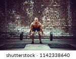 muscular fitness man doing... | Shutterstock . vector #1142338640