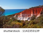 pinnacles and ocean. this... | Shutterstock . vector #1142353139