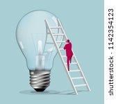 businessman climbs a huge light ...   Shutterstock .eps vector #1142354123