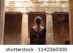 Woman Explores Ancient Tomb Of...