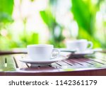 close up white coffee cup put... | Shutterstock . vector #1142361179
