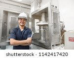 happy engineer holding a wrench ... | Shutterstock . vector #1142417420