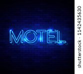 motel neon sign on the brick... | Shutterstock . vector #1142435630