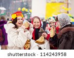 Women  eating pancakes during  Shrovetide in Russia - stock photo