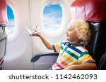 child in airplane. kid in air... | Shutterstock . vector #1142462093