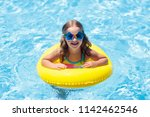 child with inflatable ring in... | Shutterstock . vector #1142462546