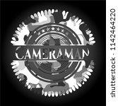 cameraman on grey camouflage... | Shutterstock .eps vector #1142464220