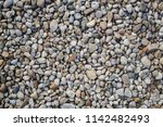 many black stone and small... | Shutterstock . vector #1142482493