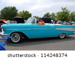 FREDERICK, MD- SEPTEMBER 16: Unidentified Man Driving 1957 Chevrolet Bel Air Convertible on Sept. 16, 2012 in Frederick , MD USA. Alzheimer's Association Benefit Car Show at MVA in Maryland. - stock photo