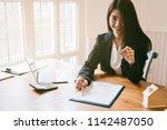 realtor is giving the keys to... | Shutterstock . vector #1142487050