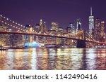 brooklyn bridge and manhattan... | Shutterstock . vector #1142490416