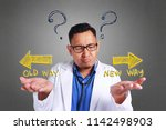 a young asian confused doctor... | Shutterstock . vector #1142498903