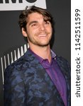 rj mitte arrives at the amc's ... | Shutterstock . vector #1142511599