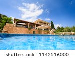 the private spanish house in... | Shutterstock . vector #1142516000