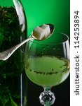 Small photo of Absinthe with sugar close-up