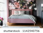 grey sheets on pink bed in... | Shutterstock . vector #1142540756