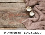 warm soft blanket and candles... | Shutterstock . vector #1142563370