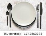 black silverware and empty...   Shutterstock . vector #1142563373