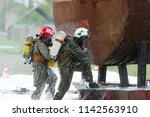 two rescuers eliminates...   Shutterstock . vector #1142563910