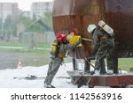 two rescuers eliminates...   Shutterstock . vector #1142563916