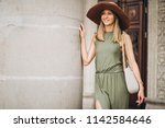 beautiful woman in dress and... | Shutterstock . vector #1142584646