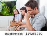 three patients sitting in... | Shutterstock . vector #114258730