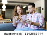 young happy wife and husband...   Shutterstock . vector #1142589749