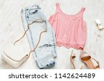 pink top  blue jeans  small... | Shutterstock . vector #1142624489