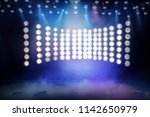 stage spot light with smoke | Shutterstock . vector #1142650979